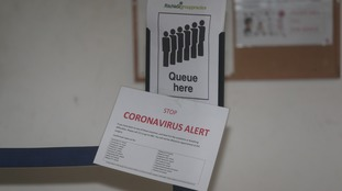 Health centres in London have begun distributing 'coronavirus alert' signs.