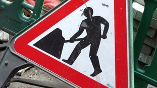 Triangle roadwork sign
