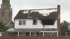 Family of four escape burning home from first floor window