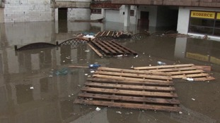 The River Vltava has carried tree branches and other debris into the city centre