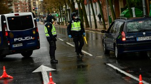 Spanish policemen wearing protecting masks control the access in Logrono, northern Spain.