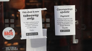 A chain of Greggs advises customers of new takeaway and payment rules.
