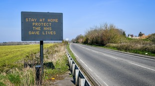 A matrix road sign on the A367 into Bath advises motorists to stay at home to protect the NHS and save lives.