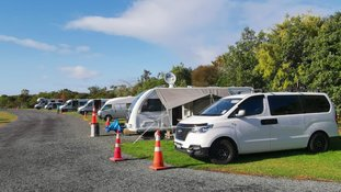 Nikki and Tim Johnson are staying in a camper van in Ambury Park near Auckland.