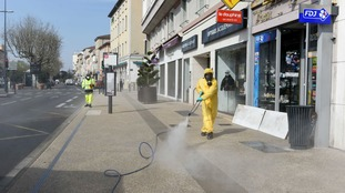 A street in Romans-sur-Isere is cleaned.