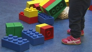 Child's feet and building blocks