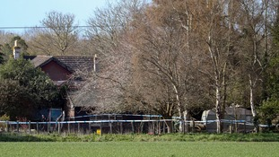 Police launch murder investigation after family of four found dead in Sussex
