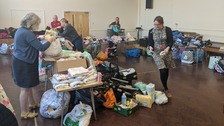 school hall full of clothes etc