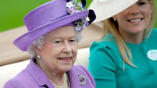Queen Elizabeth II arrives with Autumn Phillips for day three of the Royal Ascot meeting at Ascot Racecourse, Berkshire