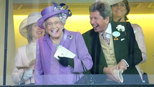The Queen celebrates with her racing manager John Warren after her horse, Estimate, won the Gold Cup on day three of the Royal Ascot.