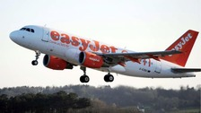 An EasyJet plane taking off into the sky
