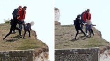 Safety warnings as girl pictured peering over cliffs at Birling Gap