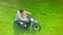 Shocking image shows biker on off-road motorcycle with a toddler sat on his lap