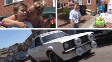 A classic car convoy lines the street for little boy's birthday