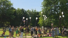The family releaseing balloons at the graveside of Laura Boon and her daughter Ella Dalby