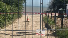 Homes evacuated after cliff fall