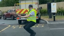 McDonald's drive-thru worker directs traffic by dancing