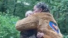 Skipton mum dons bear costume to surprise daughters after three months apart