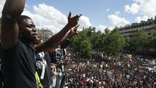 Thousands of people take part in a march against police brutality and racism in Paris
