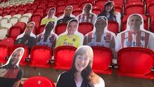 Cutouts of fans on seats at Exeter City