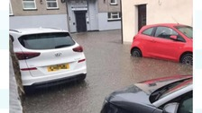 Flooded streets and homes in south Wales