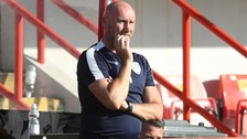 Colchester United Head Coach John McGreal watches on as his team is beaten in the SkyBet League Two Playoff semi-final 2nd leg at Exeter