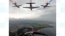 Red Arrows leave a trail of red white and blue across North Yorkshire