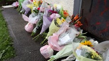 Flowers laid at the scene where a man was stabbed to death in the Ballykeel area of Ballymena