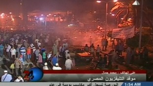 Local TV picture of the aftermath of clashes outside Cairo University in Egypt