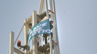 A Greenpeace activist unveils a Save The Arctic flag on top of the Shard Building