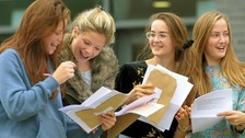 Two sets of twins - Minnie Crawley, Tallulah Crawley, Florence Hislop and Dorothy Hislop open their GCSE results.