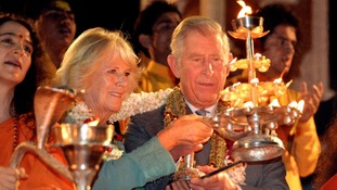 The Prince and Duchess light candles during a ceremony on the banks of the Ganges.