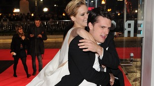 Jennifer Lawrence and Josh Hutcherson arrive at the premiere of Hunger Games: Catching Fire.