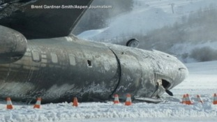 The charred front section of the fuselage