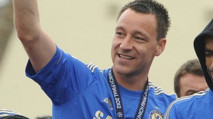 Chelsea captain John Terry waves during the FA Cup and UEFA Champions League trophy parade in London