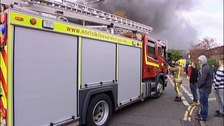 A Norfolk fire engine responding to a call