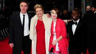 British film star Emma Thompson poses with family on the Bafta award red carpet.