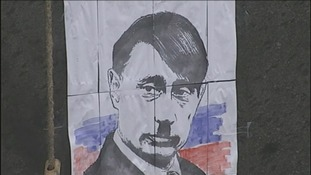 A cartoon depicts Russian President Vladimir Putin as Hitler