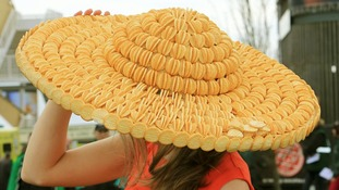Sarah Morris says cheese as she shows off her hat made from Mini Cheddars.