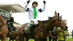 Leighton Aspell celebrates after winning the Grand National with Pineau De Re.