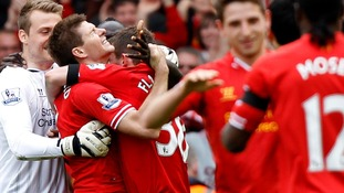 Steven Gerrard celebrates with his team after their victory over Manchester City at Anfield.