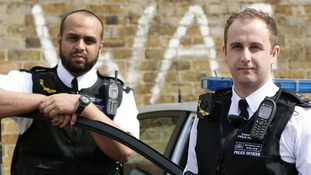 Constable Yasa Amerat (left) and Constable Craig Pearson wear their body-worn video (BWV) cameras.