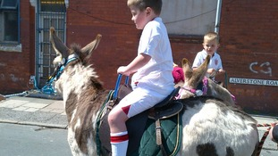 Donkey rides at a street party on the Wirral
