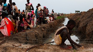 Women and children wait for food at a refugee camp in South Sudan.
