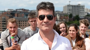 Simon Cowell denies being gay