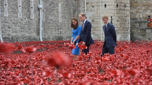 The Duke and Duchess of Cambridge with Prince Harry view the Tower of London's 'Blood Swept Lands and Seas of Red' poppy installation to commemorate the 100th anniversary of the outbreak of First World War.