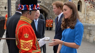 The Duchess of Cambridge talks to a Yeoman Warder as she arrives for a visit to the Tower of London