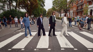 The stars of the West End musical 'Let it be' recreated the Beatles' famous Abbey Road crossing pose today.