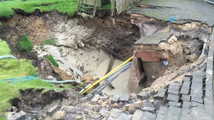 Sinkhole opens up in family garden
