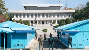 North and South Korean soldiers stand along the border in the demilitarized zone